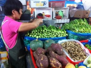 The bok choy lady wanted to sell them about 35 pounds of bok choy and just kept shoving the vegetables into a bag even as we said NO NO NO.  What a great sales technique.
