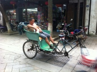 While it was a beautiful day, it was definitely one of the hotter ones we had had in a while here in China. And the people of Tongli were definitely feeling it. This guy had figured out the way to handle the heat quite effectively though.