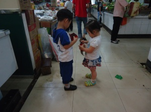 These kiddos were having fun at the wet market!