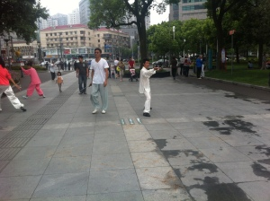 The best representation of the madness of Zhongshan Park.  A guy walking around with his sword as people do tai chi in their tai chi clothes...and not how no one around them is phased at all.