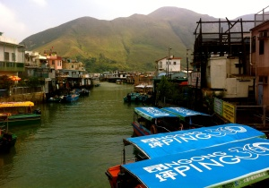 Tai O fishing village.  Took a boat ride here for 20 HKD and saw the famous Lantau Island pink dolphins literally jumping out of the water right by the boat.  Little show-offs.