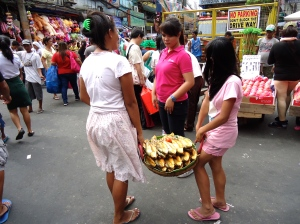 These ladies were at the front of the market, greeting customers with some...fish?