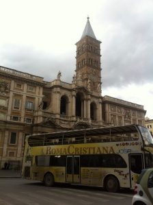 The outside of Santa Maria Maggiore while the Roma Cristiana bus zooms by on its way to the next stop on the list.